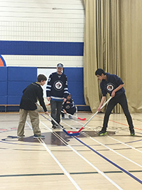 MSD students playing floor hockey