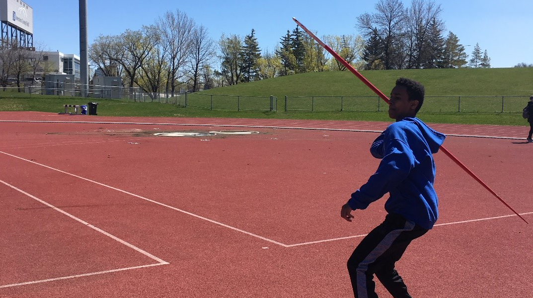 An MSD student throwing a Javelin